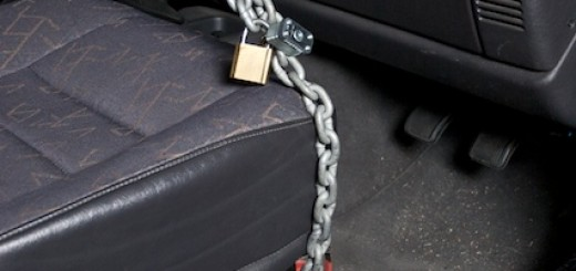 chain wrapped around base of seat then around the steering wheel